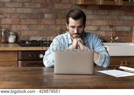 Pensive Caucasian Man Work On Computer Thinking