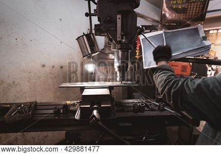 Milling Machine Working Near Worker With Gloves. Tool For Cut Metal Workpiece. Vertical Milling Mach