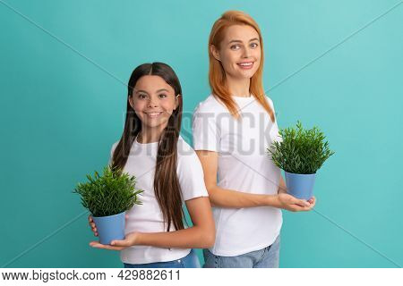 Adoptive Family Of Adopted Daugher Child And Woman Mother Smile Holding Pot Plants, Foster