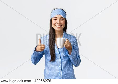 Morning Lifestyle, Breakfast And People Concept. Upbeat Smiling Pretty Asian Girl In Sleeping Mask A