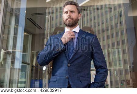 Successful Man In Businesslike Suit. Entrepreneur Outside The Office. Male Formal Fashion.