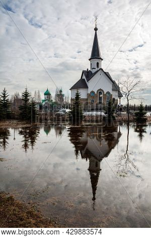 Church Of St. George The Victorious On Srednaya Rogatka (middle Slingshot) Is Reflected In A Huge Po