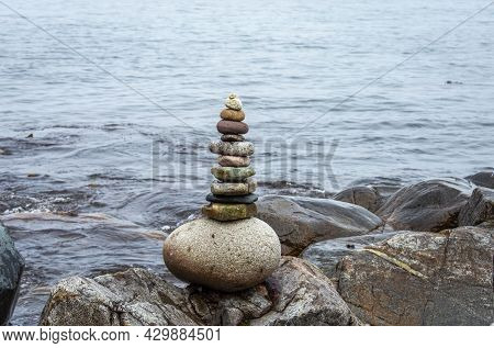 Stack Of Stones Near The Sea With Water At Background.