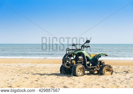 Vintage Green Atv On The Sandy Beach. Quad Atv All Terrain Vehicle Parked On Beach, Motor Bikes Read