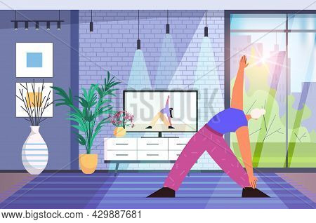 Senior Woman Doing Yoga Fitness Exercises Watching Tutorials On Tv Online Training Healthy Lifestyle