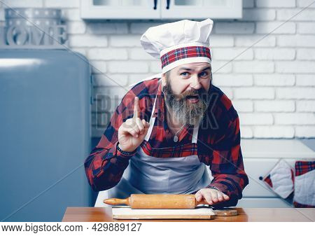 Bearded Man Present Dish. Professional Cook. Chef In Cook Apron.