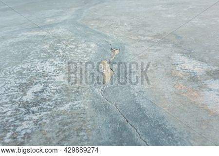 Hairline Crack Of Concrete. That Damage On Surface Floor Or Slab After Repair By Joint Filler, Plast
