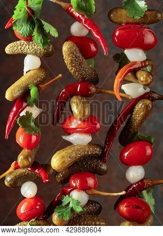Preserved Vegetables. Marinated Cucumbers, Tomatoes, Peppers, And Onions Garnished With Green Corian