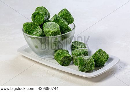 Shock-frozen Spinach Briquettes Are An Alternative To Fresh Produce. Concept Of Healthy Eating. Copy