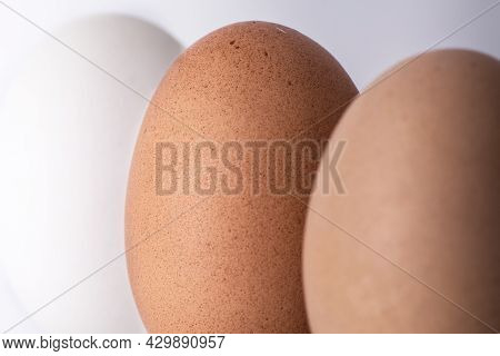 Three (3) Different Shades Of Natural Organic Eggs On A White Background. Diversity And Difference C