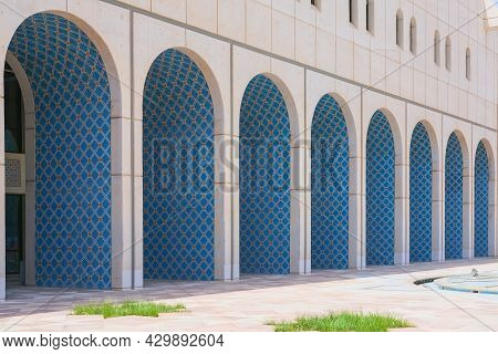 Perspective View To White Facade Wall Of Building With Row Of Oriental Arches Ornate Designed Blue A