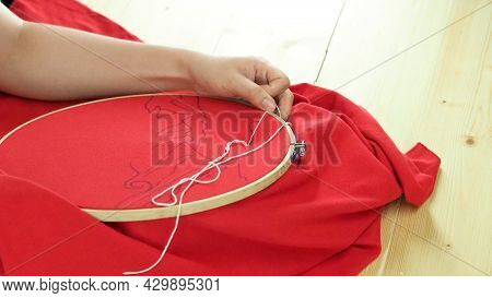 Woman Hands And Craft Work. Embroider Sewing By Hand.