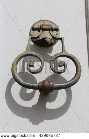 Old And Ancient Knocker In The City Of Nimes