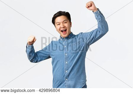 Successful Winning Man Rejoicing Over Victory, Raising Hands Up In Hooray Gesture, Saying Yes, Achie