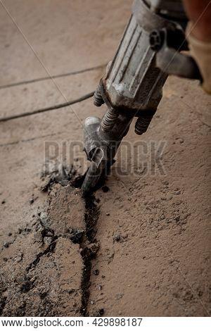 Road Repair. Using An Electric Hammer. Roadwork