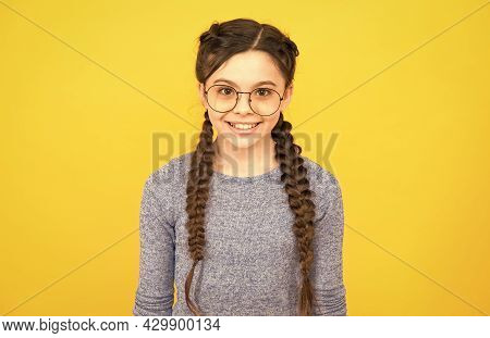 Giving The Girl Confidence And Precision. Happy Girl Wear Glasses Yellow Background. Fashion Look Of