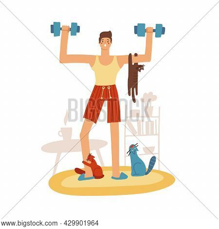 Attractive Young Man Doing A Home Workout. Tree Naughty Cats Are Sitting On Hin And Diverting. The G