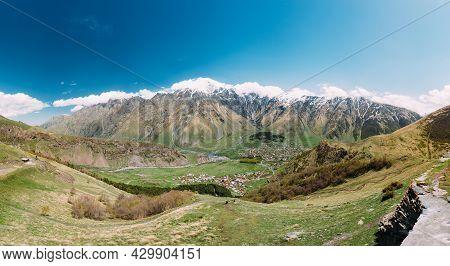 Stepantsminda Village At Sunny Day In Kazbegi District, Mtskheta-mtianeti Region, Georgia. Panorama