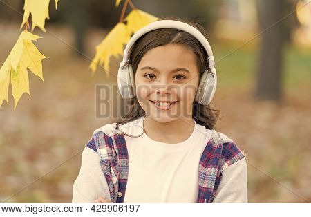 Simply Music Feelings. Cute Little Child Listen To Music Playing In Stereo Headphones. Adorable Girl
