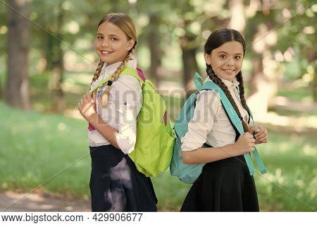Happy Children Carry School Bags In Formal Uniform Outdoors, Back To School