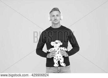 Childish And Infantile. Childish Adult Hold Toy Dog Yellow Background. Imaginative Friend. Pretend P