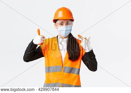 Covid-19 Safety Protocol At Enterpise, Construction And Preventing Virus Concept. Asian Female Chief