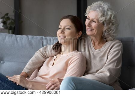 Happy Old Mother And Grownup Daughter Relax Dreaming