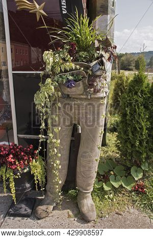A Unique Planter For House Hold Plants Made Of Army Camo Pants Stands Outside An Antique Store In In