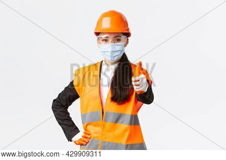 Covid-19 Safety Protocol At Enterpise, Construction And Preventing Virus Concept. Confident Asian Fe