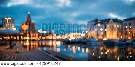 Helsinki, Finland. Abstract Blurred Bokeh Architectural Urban Panoramic Background Of Uspenski Cathe