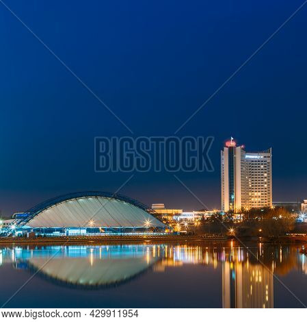 Minsk, Belarus. Old Soviet Hotel Building In Central Part Minsk, Downtown Nemiga. View With Water Re