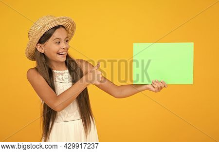 Kid Traveler. Summer Sales. Happy Little Girl Hold Poster Copy Space. Vacation Time. Girl Straw Hat.