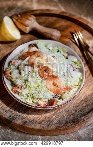 Healthy Shrimp Caesar Salad Bowl With Parmesan Cheese And Lemon