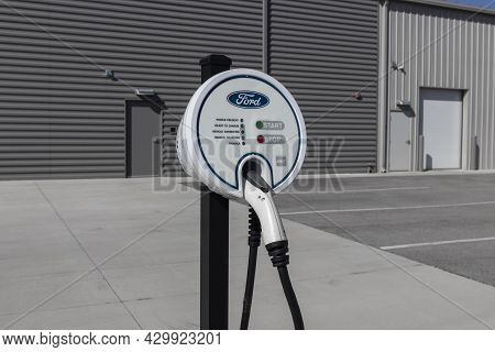 Kokomo - Circa August 2021: Ford Electric Charging Station For The Mustang Mach-e, Fusion Plug-in An