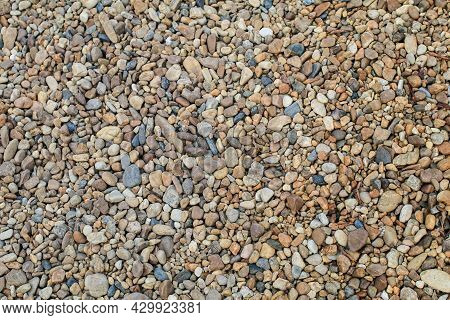 Abstract Background With Round Pebble Stones. Fine Gravel, Natural Stones. Empty Space On The Backgr