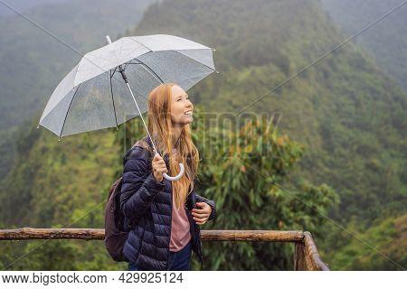 Woman Tourist With Umbrella In Sapa In The Fog, Northwest Vietnam. Vietnam Travel Concept. Unesco He