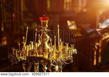 A Splendor Floor Church Candle Holder With Burning Candles Shot Close-up On A Dark Background. Selec