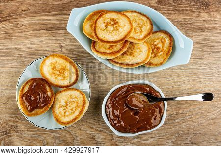 Oval Plate With Pancakes, Sandwich From Pancake With Condensed Milk In Saucer, Teaspoon In Light-blu