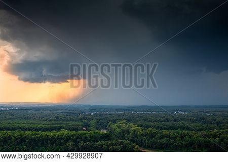 The Onset Of Stormy Weather With Heavy Rain Over A Forest Village