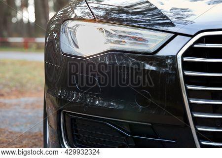 Grodno, Belarus - December 2019: Audi A6 4g C7 Luxury Black Car Parts Right Front Xenon Luminous Hea