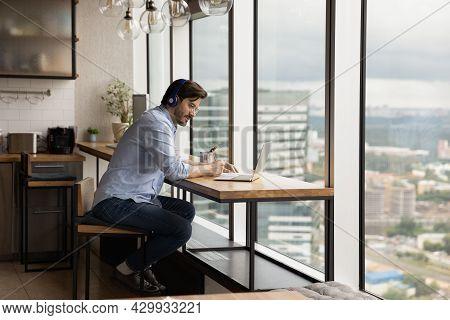 Man Studying Wear Wireless Headphones Listen Audio Course Making Notes