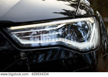 Grodno, Belarus - December 2019: Audi A6 4g C7 Luxury Black Car Parts Left Front Bixenon Headlight W