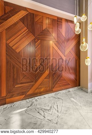 Angled View Of Hall With Wood Cladding Wall Decorated With Geometrical Patterns, Modern Glass Led Ta