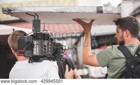 Behind Scenes. Film Crew Team Shooting Movie Scene. Group Filmmaking