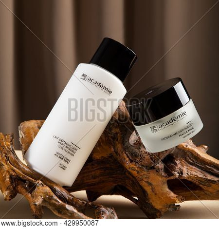 Skin Care Cosmetics Of French Brand Academie Paris. Cream And Cleanser For Skin On Wooden Bark Beige