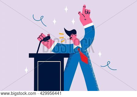 Public Speaking And Politics Concept. Young Man Politician Standing Speaking With Emotions From Trib
