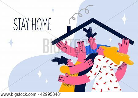 Stay At Home During Pandemic Concept. Young Smiling Family With Child Hugging Staying At Home Under