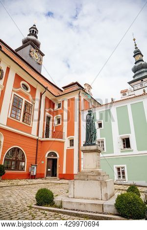 Pelhrimov, Czech Republic, 03 July 2021: Renaissance Castle With Red Facade, Mansard Roof With Prism