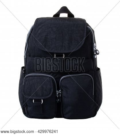 Black Backpack For Men, Made Of Fabric With Silver Zippers. Model With A Flap And Pockets. On A Whit
