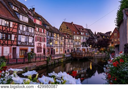 Colmar, Alsace, France. Petite Venice, Water Canal, And Traditional Half Timbered Houses. Colmar Is